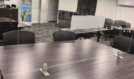 Straight(model) space divider, using clear acrylic. Two chairs are placed at this table.