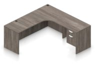 """Orthographic view of an Offices to Go 71"""" corner desk with left side extension. Its inner edge is curved, and it has a set of two hanging office drawers to the right of it, with a lock on the top. This layout is featured in an Artisan Grey finish."""