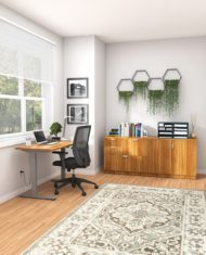 Studio shot of OTG's Home Office Setup, which has a height-adjustable work desk with a tungsten colored frame. To the side of the mesh back chair is the included mixed storage unit, with different drawer sizes. Both surfaces are finished in an Autumn Walnut finish.