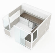 Full 8x8 foot cubicle, set as a manager and group workspace. Desking is placed along two walls, with a wide set of filing drawers on one side. A frosted acrylic door is slid to the right, for people to enter. Model is CM519.