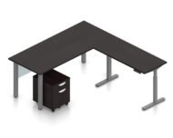 """Orthographic view of an Offices to Go desk and table set, using Layout 4. This L-shaped desking consists of a 71"""" wide metal table with a 48"""" height adjustable table attached at a 90 degree angle. A rolling file pedestal is under the table, consisting of 2 drawers with a top lock. An acrylic privacy panel is mounted at the front of (underneath) the table. This layout is shown with the American Espresso laminate finish."""